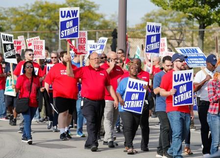 Striking United Auto Workers (UAW) walk the picket line in Hamtramck