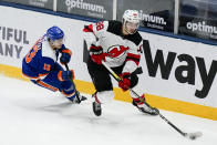 New York Islanders' Mathew Barzal (13) defends against New Jersey Devils' Kevin Bahl (88) during the third period of an NHL hockey game Thursday, May 6, 2021, in Uniondale, N.Y. The Devils won 2-1. (AP Photo/Frank Franklin II)