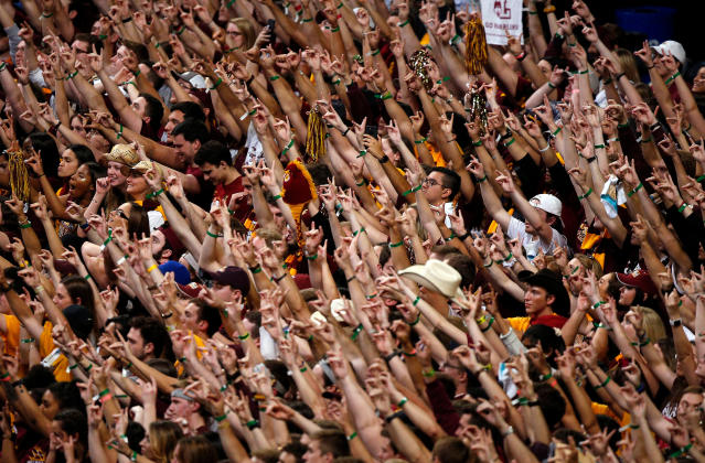 Loyola-Chicago fans cheer during the second half in the semifinals of the Final Four NCAA college basketball tournament against Michigan, Saturday, March 31, 2018, in San Antonio. (AP Photo/Brynn Anderson)