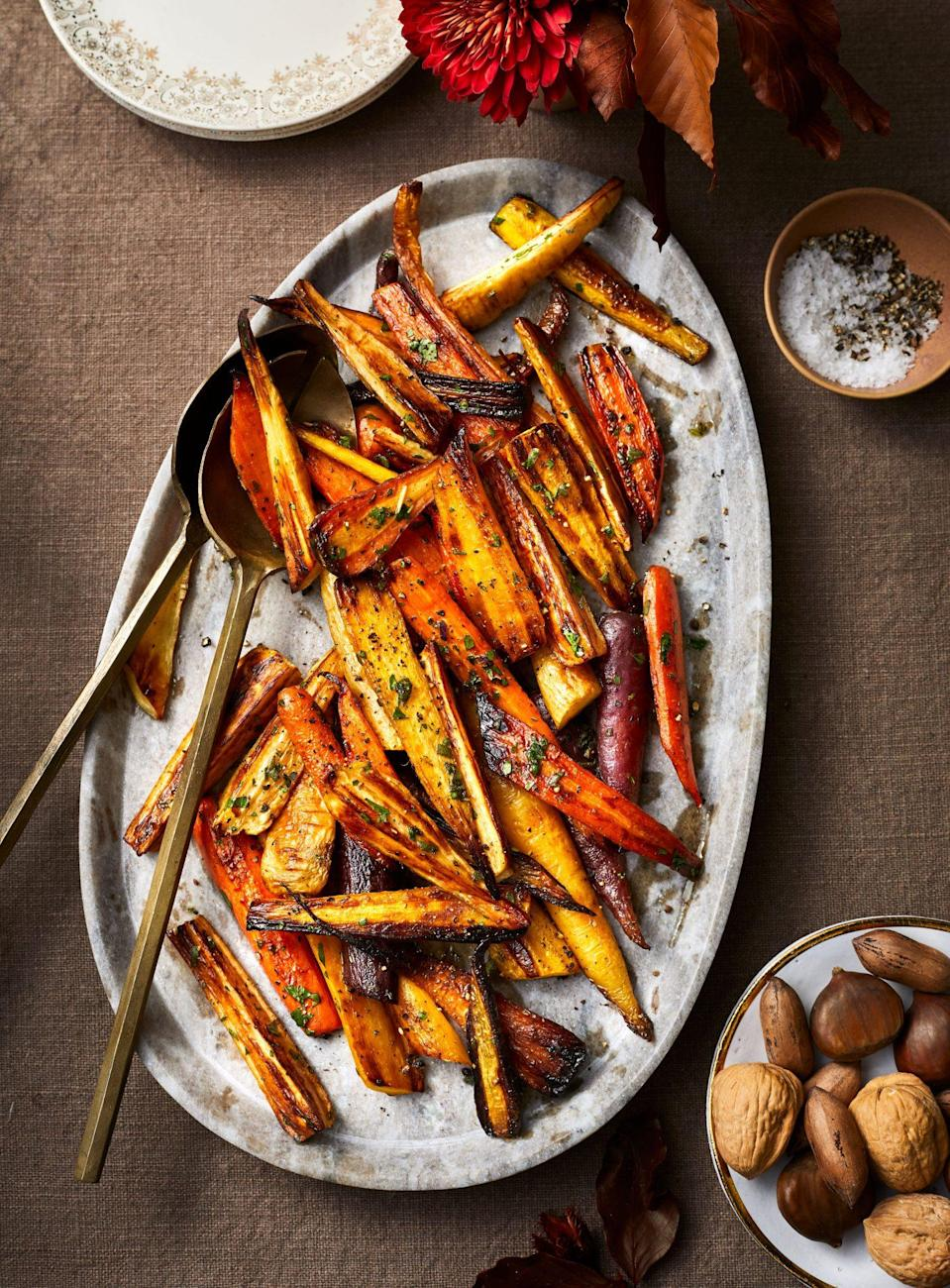 """<p><strong>Recipe: <a href=""""https://www.southernliving.com/recipes/roasted-carrots-and-parsnips"""" rel=""""nofollow noopener"""" target=""""_blank"""" data-ylk=""""slk:Roasted Carrots and Parsnips"""" class=""""link rapid-noclick-resp"""">Roasted Carrots and Parsnips</a></strong></p> <p>If your family likes sweet potatoes, you can add them to the mix as well. </p>"""