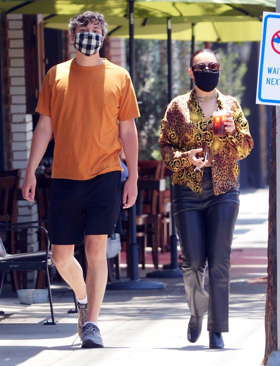 <p>Charli XCX and boyfriend Huck Kwong grab to-go coffees in Los Angeles on Thursday. </p>