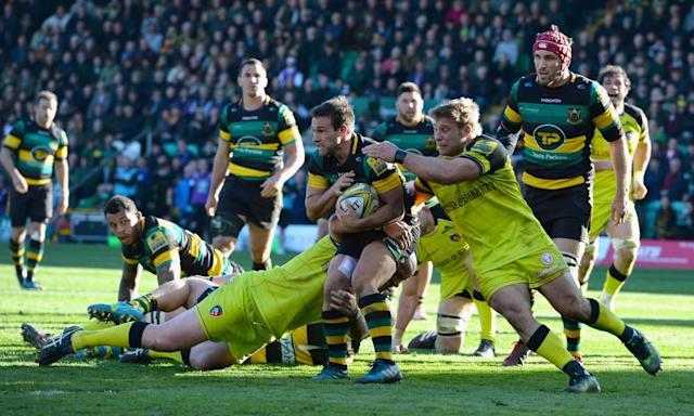 """<span class=""""element-image__caption"""">Northampton's Nic Groom is tackled by Dan Cole and Tom Youngs of Leicester Tigers during the Premiership match.</span> <span class=""""element-image__credit"""">Photograph: Tony Marshall/Getty Images</span>"""