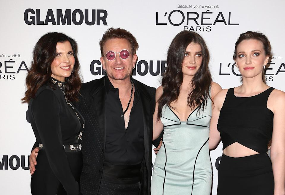 Bono with his wife Ali (left) and his two daughters.  Eve is wearing a light dress.  (Image: Wayne)
