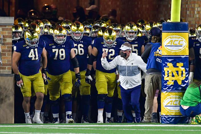 Nov 7, 2020; South Bend, Indiana, USA; Notre Dame Fighting Irish head coach Brian Kelly leads his team out of the tunnel before the game against the Clemson Tigers at Notre Dame Stadium. Notre Dame defeated Clemson 47-40 in two overtimes. Mandatory Credit: Matt Cashore-USA TODAY Sports