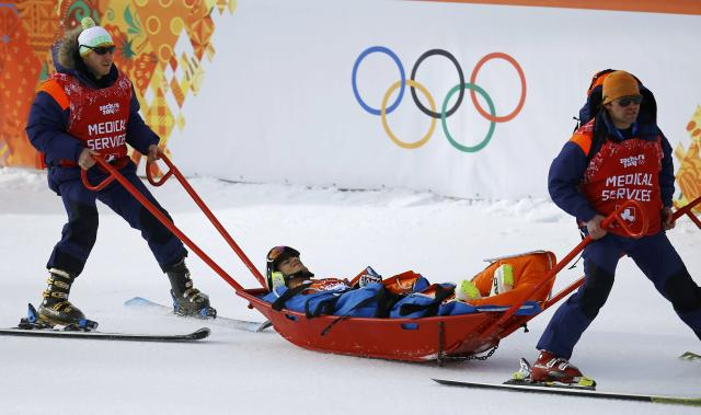 Andorra's Joan Verdu Sanchez is carried away in a stretcher after crashing out during the first run of the men's alpine skiing giant slalom event in the Sochi 2014 Winter Olympics at the Rosa Khutor Alpine Center February 19, 2014. REUTERS/Kai Pfaffenbach (RUSSIA - Tags: OLYMPICS SPORT SKIING)