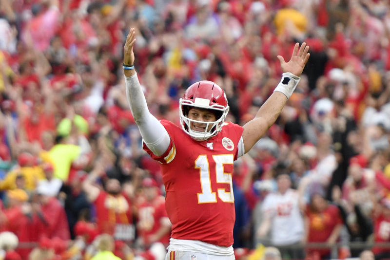 Patrick Mahomes raises his arms in celebration after a touchdown.