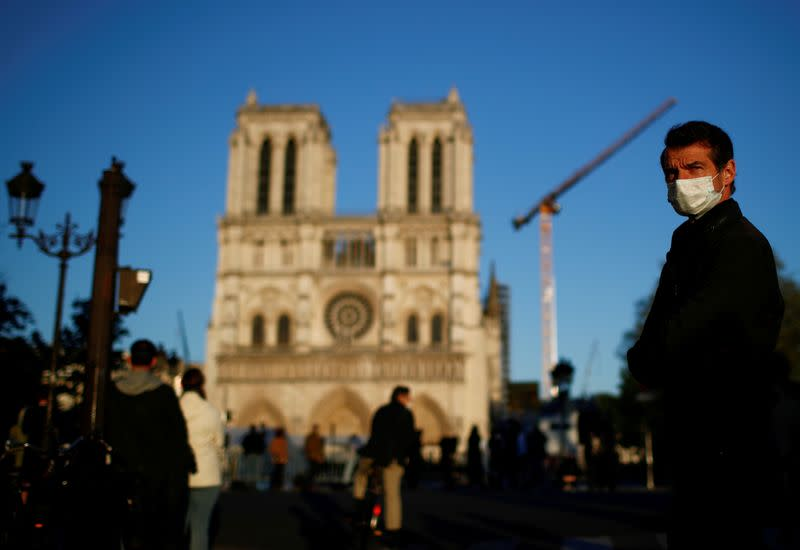 FILE PHOTO: Paris on lockdown marks one year anniversary of Notre Dame cathedral blaze
