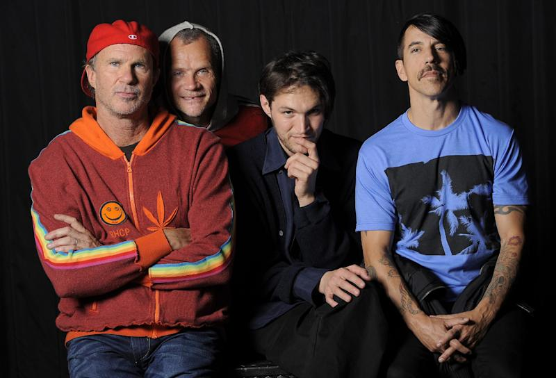 In this March 16, 2012 photo, members of the Red Hot Chili Peppers, from left, drummer Chad Smith, bassist Flea, guitarist Josh Klinghoffer and singer Anthony Kiedis pose for a portrait in the Hollywood section of Los Angeles. The group will be inducted into the Rock and Rock Hall of Fame on Saturday, April 14. (AP Photo/Chris Pizzello)