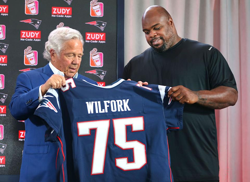 New England Patriots owner Robert Kraft presents a game jersey to former Patriot Vince Wilfork