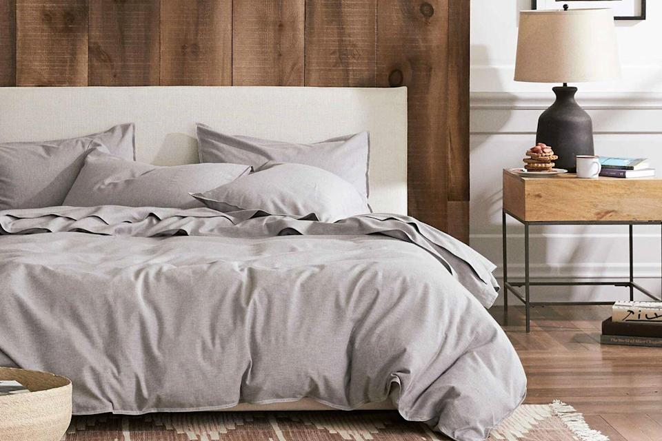 Grey bedding and bed frame