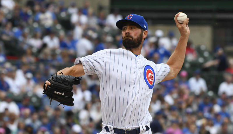 Cole Hamels leaves Cubs, Reds game after one inning with apparent injury