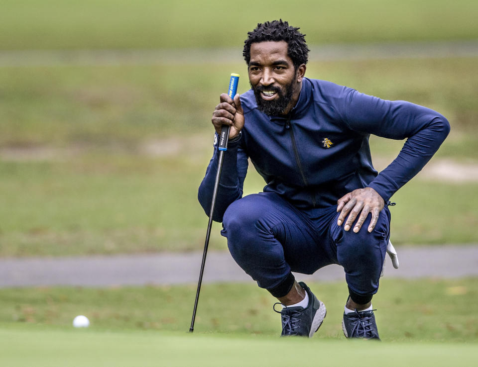 North Carolina A&T's J.R. Smith lines up his shot to the 17th green during the second round of the Phoenix Invitational golf tournament in Burlington, N.C., Tuesday, Oct. 12, 2021. Smith spent 16 years playing in the NBA, winning two world championships. (Woody Marshall/News & Record via AP)
