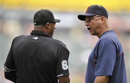 Cleveland Indians manager Terry Francona right, argues with home plate umpire Alan Porter left, during the first inning of the first game of a doubleheader baseball game against the Chicago White Sox in Chicago, Friday, June 28, 2013. (AP Photo/Paul Beaty)