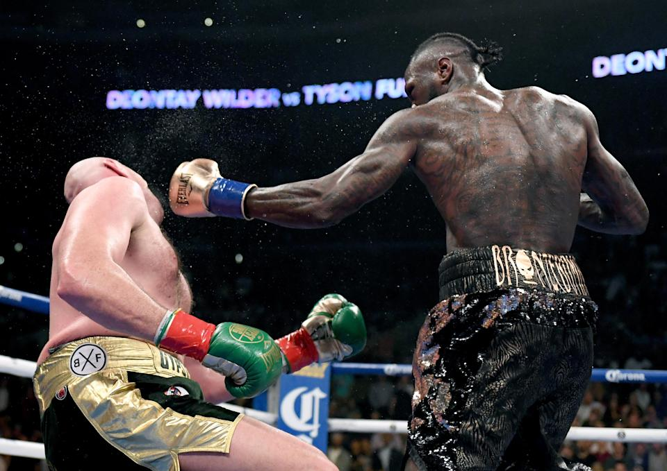 Wilder drops Fury during the WBC Heavyweight Champioinship match. Pic: Getty