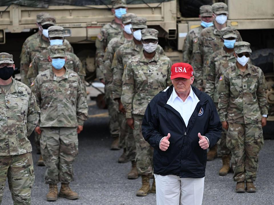 Donald Trump with National Guard troops in Lake Charles, Louisiana, on August 29, 2020 after Hurricane Laura tore through the area  (AFP)