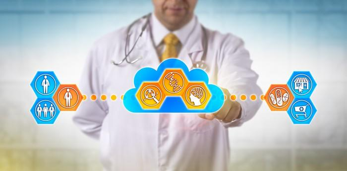A doctor with his finger on a graphic of cloud-based healthcare services.