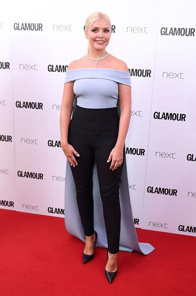 <p>We loved Holly's feminine caped jumpsuit by brand Safiyaa. However, others have not been too fond of the quirky jumpsuit. <i>[Photo: Mike Marsland/Mike Marsland/WireImage]</i></p>