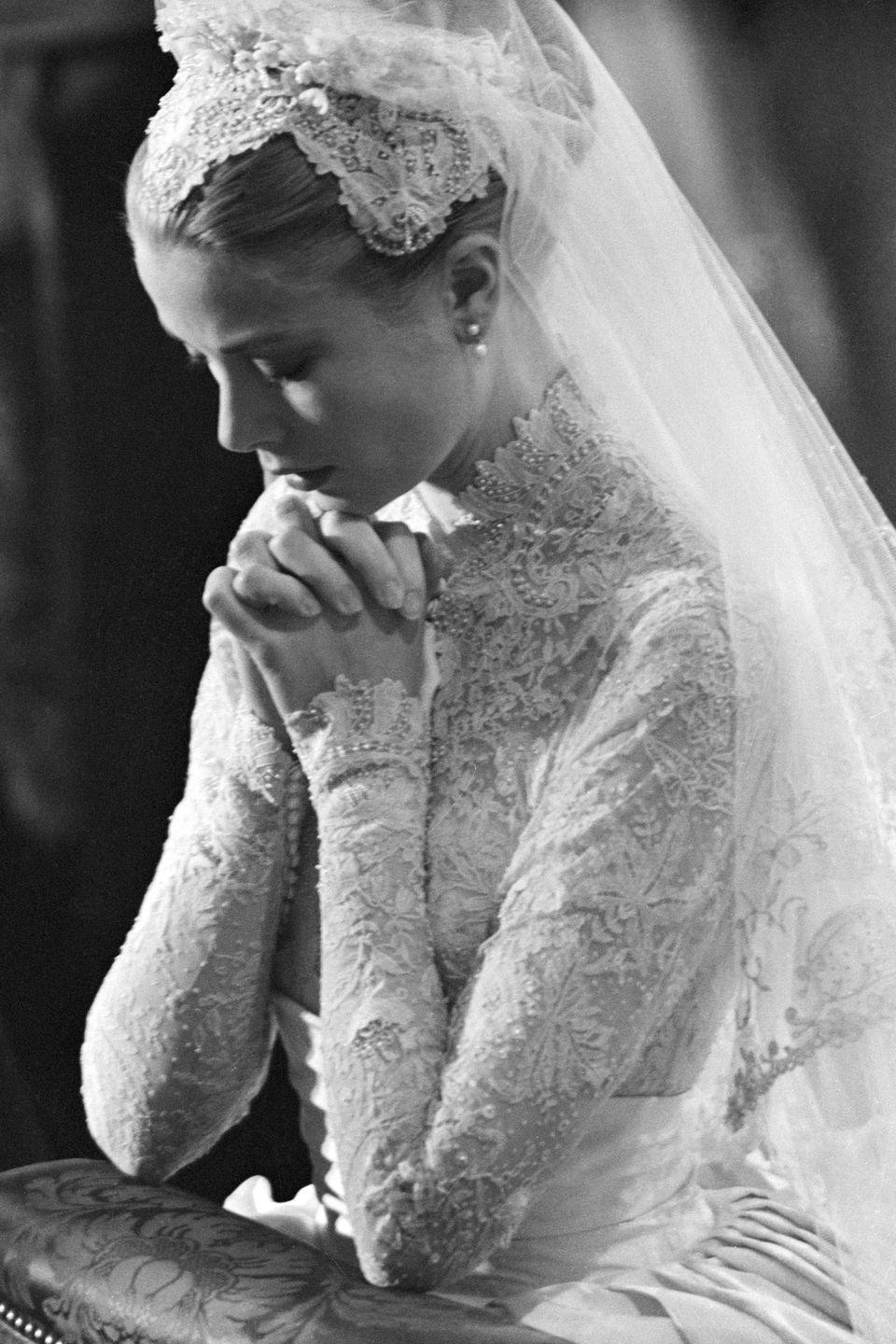 <p>Seamstresses re-embroidered the antique Brussels lace on her bodice to hide any seams and add hundreds of seed pearls.</p>