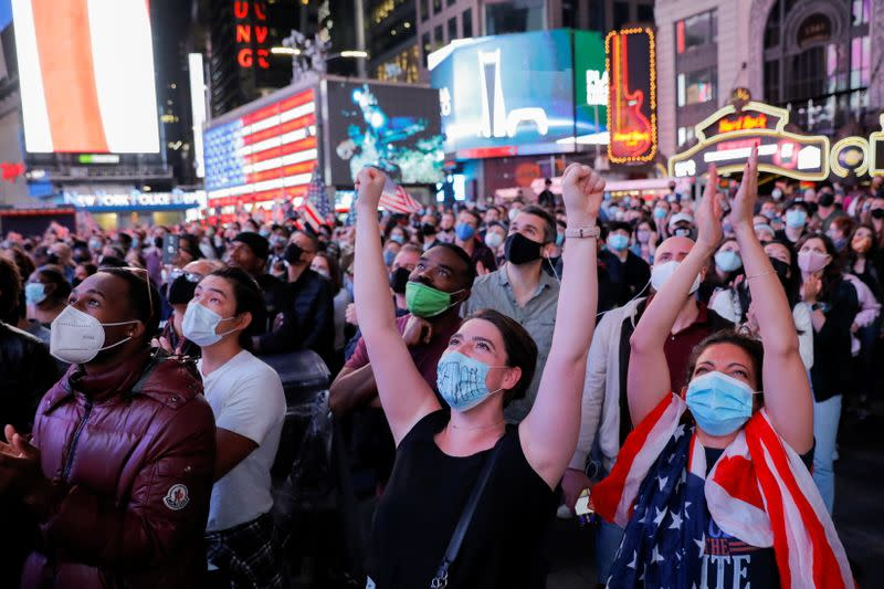 People celebrate in Times Square in New York City