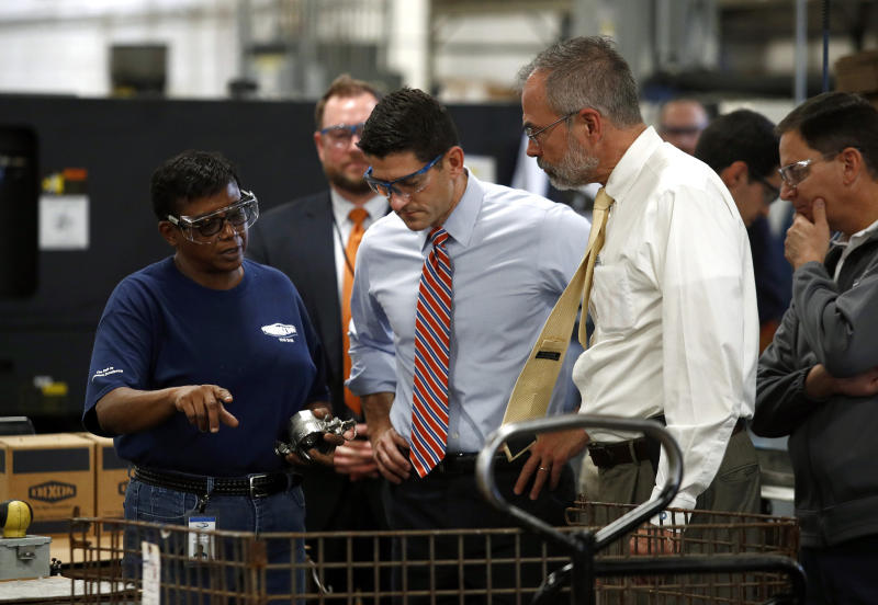 Dixon Valve & Coupling Company employee Toni Durant, left, speaks with Speaker of the House Paul Ryan, R-Wis., center, and Rep. Andy Harris, R-Md., right, during a factory tour prior to a tax reform town hall with employees in Chestertown, Md., Thursday, Oct. 5, 2017. (AP Photo/Patrick Semansky)