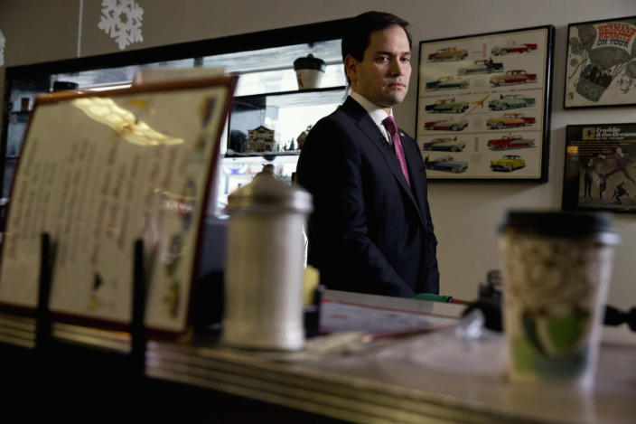 <p>Republican presidential candidate Sen. Marco Rubio waits for an interview with CBS during a campaign stop at Norton's Classic Cafe in Nashua, on Feb. 8, 2016. <i>(Photo: Jacquelyn Martin/AP)</i></p>