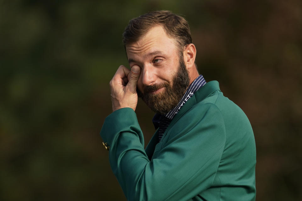 Masters golf champion Dustin Johnson wipes away a tear while being interviewed following his victory Sunday, Nov. 15, 2020, in Augusta, Ga.(AP Photo/David J. Phillip)