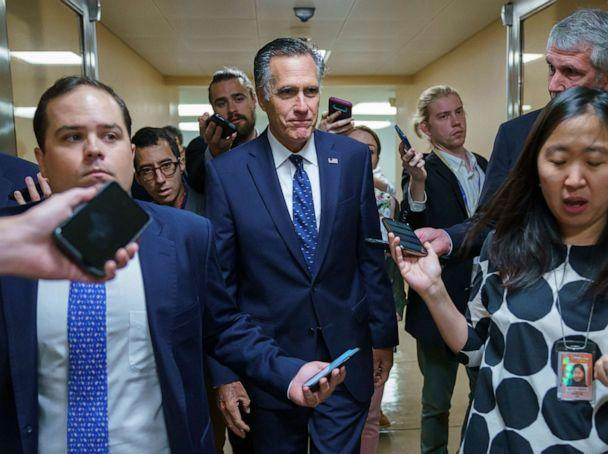 PHOTO: Sen. Mitt Romney is surrounded by reporters as he walks to the Senate chamber for votes, at the Capitol in Washington, D.C., June 10, 2021. (J. Scott Applewhite/AP)