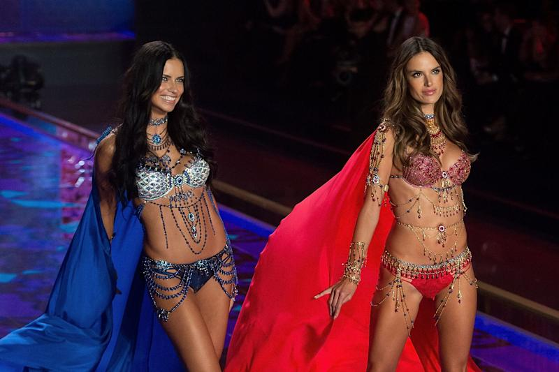 Models Adriana Lima (L) and Alessandra Ambrosio wearing the Mouawad Fantasy Bra walk the runway at the annual Victoria's Secret fashion show at Earls Court on Dec. 2, 2014 in London, England.