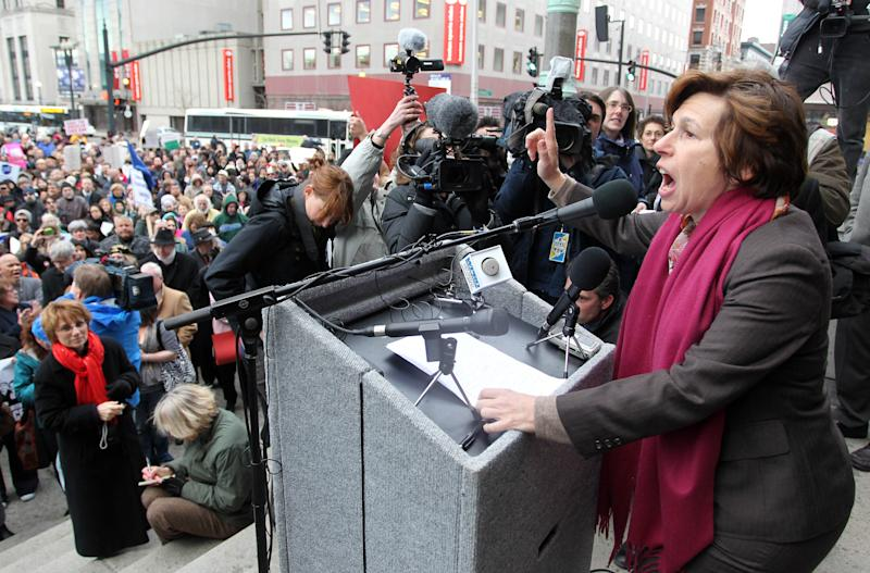 Randi Weingarten, right, president of the national American Federation of Teachers, speaks to a crowd of teachers and supporters on the steps of Providence, R.I., city Hall, Wednesday, March 2, 2011. Providence teachers and their supporters pledged to call Wednesday on Mayor Angel Taveras to rescind the firing notices he sent to all of the city's teachers during a rally on the steps of City Hall. (AP Photo/Stew Milne)