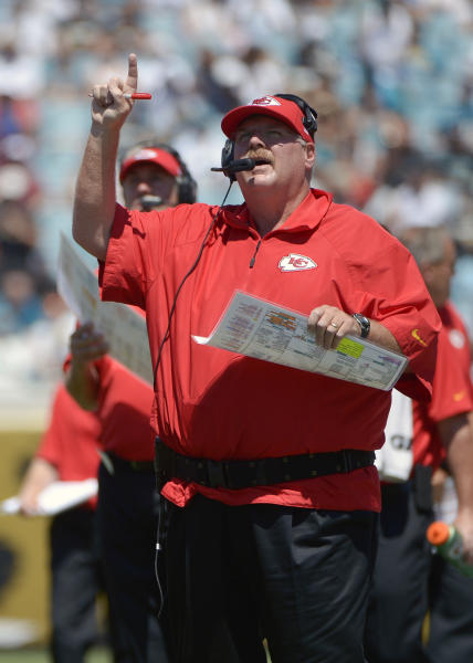 Kansas City Chiefs head coach Andy Reid motions to his players during the first half of an NFL football game against the Jacksonville Jaguars in Jacksonville, Fla., Sunday, Sept. 8, 2013.(AP Photo/Phelan M. Ebenhack)