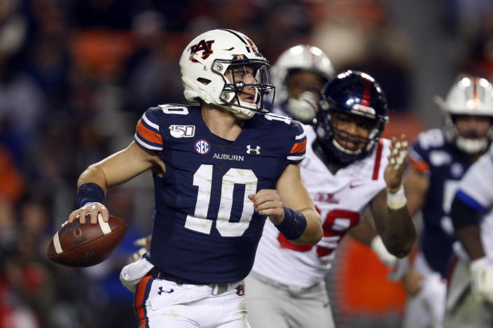 Auburn quarterback Bo Nix (10) scrambles away from pressure during the second half of the team's NCAA college football game against Mississippi, Saturday, Nov. 2, 2019, in Auburn, Ala. (AP Photo/Butch Dill)
