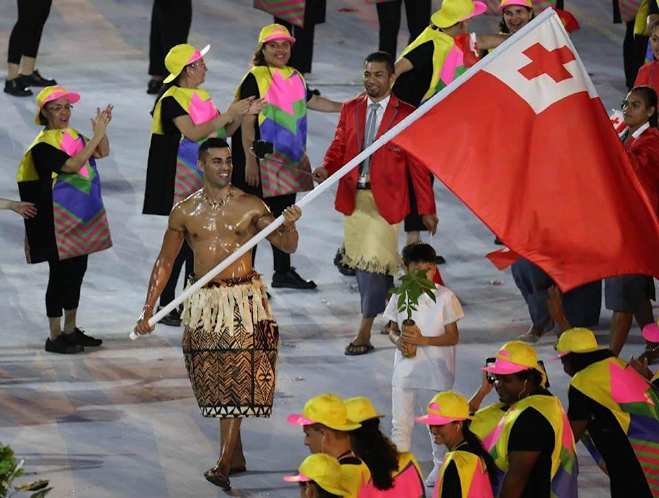 Athletes from Tonga are led by flag bearer Pita Nikolas Taufatofua during the opening ceremonies of the Rio 2016 Summer Olympic Games at Maracana.