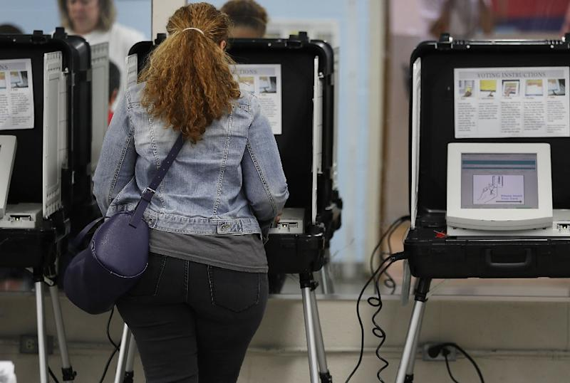 Voters cast their ballots for Georgia's 6th Congressional District in a special election (AFP Photo/JOE RAEDLE)