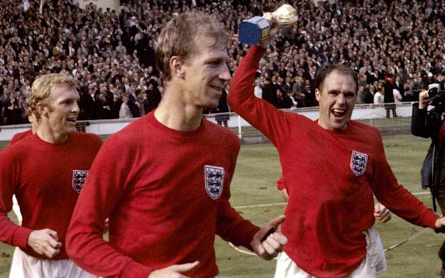 Ray Wilson has become the third of England's 1966 World Cup-winning team to die following a long battle against Alzheimer's Disease. The left-back - oldest member of Sir Alf Ramsey's team - was not well enough to attend the 50th anniversary dinner two years ago but had been living with his wife Pat in Yorkshire and had remained a regular supporter at Huddersfield Town. As well as Huddersfield, Wilson played for Everton, where he also won the 1966 FA Cup, as well as Oldham Athletic and Bradford City. He was capped 63 times for England and played every match during the 1966 World Cup finals. He worked as an undertaker in retirement and only received an MBE in 2000, some 34 years after helping England to win the World Cup. Wilson was only 69 when he was diagnosed with dementia, a disease that his 1966 England team-mates Nobby Stiles and Martin Peters are also currently suffering with. Jack Charlton is also experiencing problems with his memory. Ray Wilson (top row, second right) with the England World Cup-winning team Credit: HULTON ARCHIVE Numerous other former players are now suffering with neurological problems and, following a Telegraph campaign, the Football Association and the Professional Footballers' Association have funded a research project that has begun this year. That is 16 years after another former England international, Jeff Astle, died from a type of dementia that has since been proven to be caused by trauma to the head. In recent interviews, Wilson's family have described how he remained happy even during his illness and spent much of his later years drawing and walking. Ray Wilson slides in to take the ball away from France's Philippe Gondet in 1966 Credit: HULTON ARCHIVE For their promotion-winning 2016-17 season, Huddersfield released a new second-change kit in Wilson's honour. It was designed with the tag line 'Legends Are Rarely Made' and, 50 years on from England's greatest football triumph, was in the same red as the 1966 World Cup-winning kit. The kit had Wilson's signature in white, beneath the collar on the back, and below the white badge on the front.