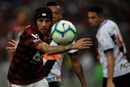 85682675_Brazil's Flamengo player Rafinha looks at the ball during the 2019 Brazilian National F.jpg