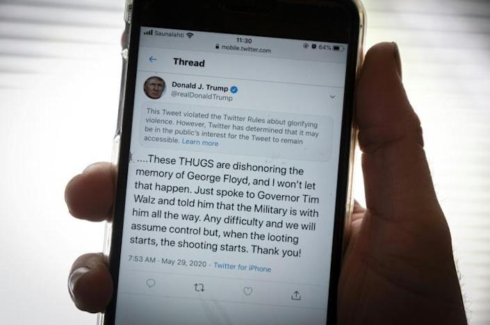 """Twitter slapped a warning label on a tweet from President Donald Trump and a similar one from the White House which the company said violated its policy of """"glorifying violence"""" (AFP Photo/Olivier MORIN)"""