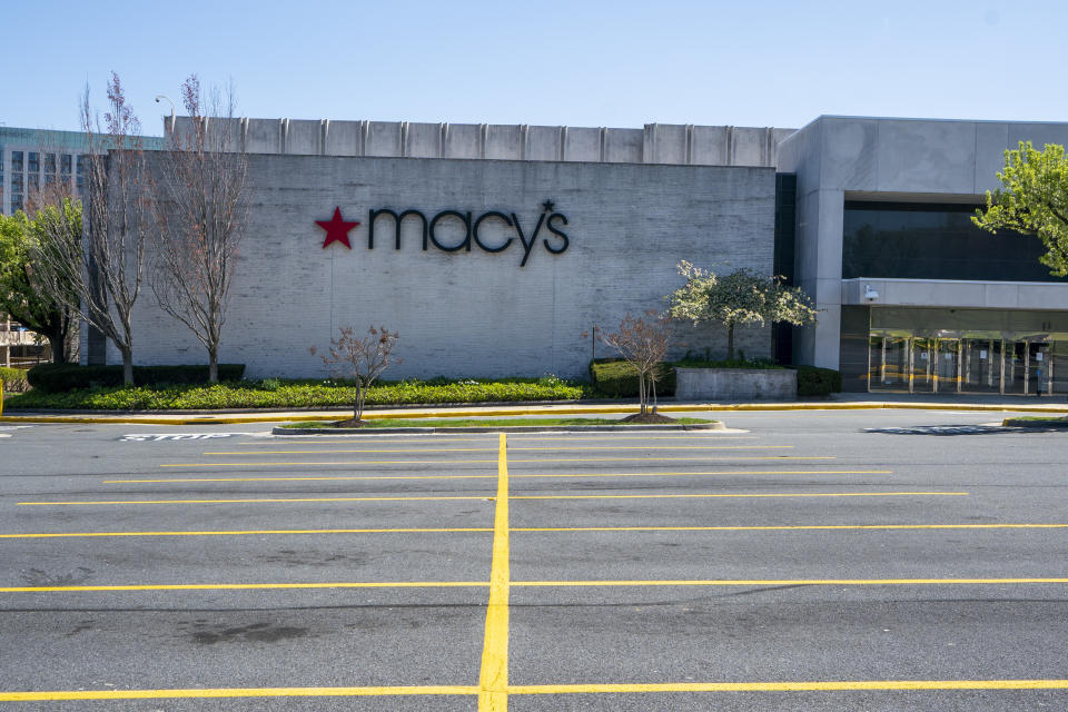 The Macy's store at the popular Tyson's Corner Center sits closed Monday, March 30, 2020, in McLean, Va., a Washington, D.C., suburb. Macy's announced that they would furlough a majority of their 130,000 workers after their stores closed due to the virus outbreak.  (AP Photo/J. Scott Applewhite)