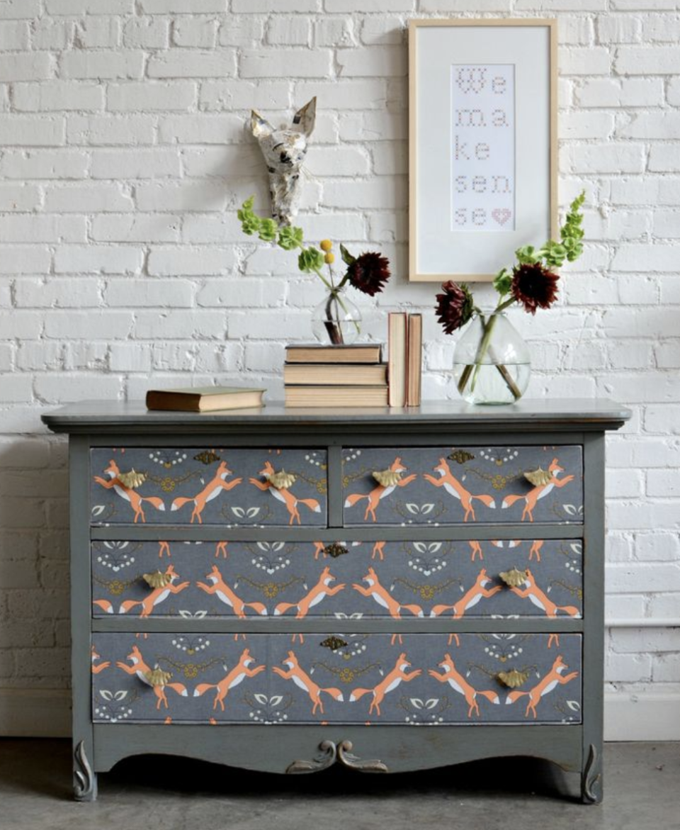 "<p>To give this old dresser a whimsical look, Barb Blair of <a href=""https://www.knackstudios.com/"" rel=""nofollow noopener"" target=""_blank"" data-ylk=""slk:Knack Studios"" class=""link rapid-noclick-resp"">Knack Studios</a> covered the drawer fronts in peel-and-stick paper! The cute <a href=""https://www.spoonflower.com/en/wallpaper/460883-foxen-by-holli_zollinger"" rel=""nofollow noopener"" target=""_blank"" data-ylk=""slk:fox print"" class=""link rapid-noclick-resp"">fox print </a>is from Spoonflower. </p>"