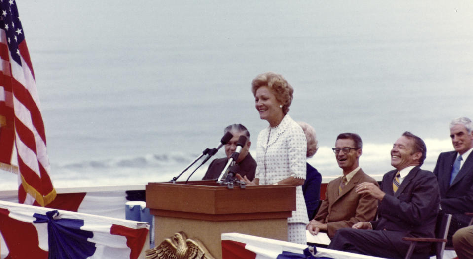"""Then-first lady Pat Nixon speaks at the dedication of Frriendship Park in San Diego, on the border with Tijuana, Mexico, on Aug. 18, 1971. In the days before Joe Biden became president, construction crews worked quickly to finish Donald Trump's wall at an iconic cross-border park overlooking the Pacific Ocean that then-first lady Pat Nixon inaugurated in 1971 as symbol of international friendship. Biden on Wednesday, Jan. 20, 2021 ordered a """"pause"""" on all wall construction within a week, one of 17 executive edicts issued on his first day in office, including six dealing with immigration. (Richard Nixon Presidential Library and Museum via AP)"""