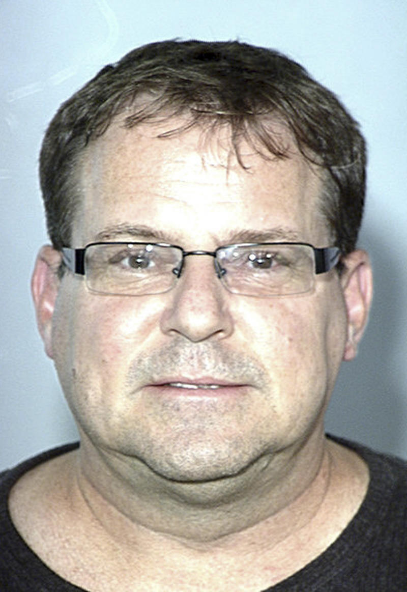 FILE - This image provided by the Las Vegas Metropolitan Police Department shows David Schubert. Schubert, a former prosecutor-turned-fugitive who once handled the high-profile drug cases of celebrities Paris Hilton and Bruno Mars has been found dead in his Las Vegas home. (AP Photo/Las Vegas Metropolitan Police Department, file)