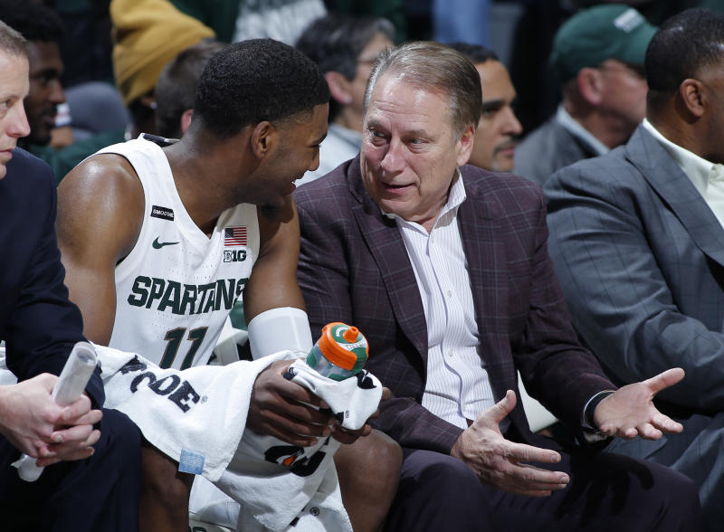 Michigan State coach Tom Izzo, right, talks with Aaron Henry on the bench during the second half of an NCAA college basketball game against Eastern Michigan, Saturday, Dec. 21, 2019, in East Lansing, Mich. (AP Photo/Al Goldis)