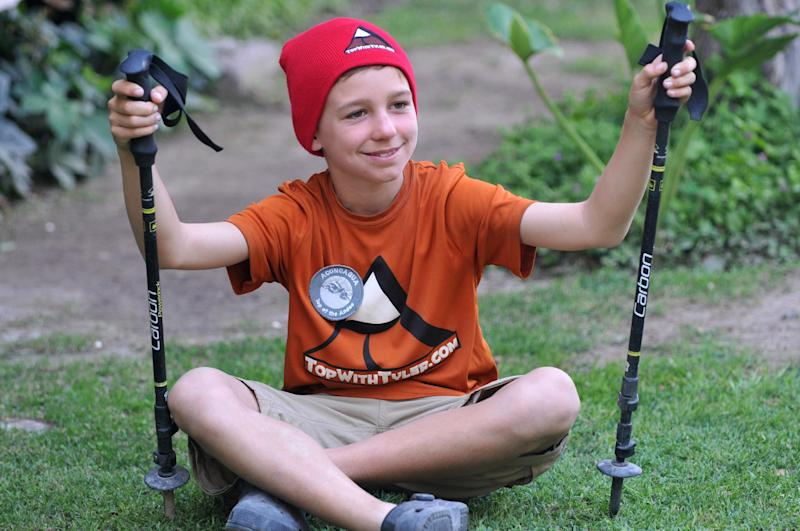 Tyler Armstrong, from Southern California, poses for a portrait as he arrives to a hotel in Mendoza, Argentina, Friday, Dec. 27, 2013. The 9-year-old boy from has become the youngest person in recorded history to reach the summit of Argentina's Aconcagua mountain, the tallest peak in the Western and Southern hemispheres. (AP Photo/Claudio Gutierrez)