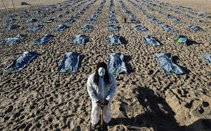 Activists in Rio de Janeiro laid out 400 fake body bags in a ceremony to mark the deaths of 400,000 Covid victims - Shutterstock