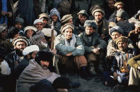 FILE - In this 1984 file photo, Afghan guerrilla leader, Ahmad Shah Massoud, center, is surrounded by Mujahideen commanders at a meeting of the rebels in the Panjshir Valley in northeast Afghanistan. In August 2021, the last remnants of Afghanistan's shattered security forces have vowed to resist the Taliban in the remote Panjshir Valley north of Kabul, that has defied conquerors before. Under the leadership of Massoud, fighters in the Panjshir Valley held off the Soviets in the 1980s and the Taliban a decade later. Any attempt to re-enact his exploits appears likely to fail, posing little threat to the country's new Taliban rulers. (AP Photo/Jean-Luc Bremont, File)