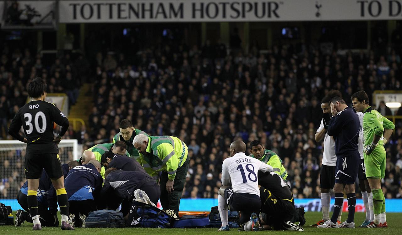 LONDON, ENGLAND - MARCH 17:  Ryo Miyaichi and manager Owen Coyle of Bolton Wanderers look on distraught with other players as Fabrice Muamba of Bolton Wanderers receives CPR treatment on the pitch after suddenly collapsing during the FA Cup Sixth Round match between Tottenham Hotspur and Bolton Wanderers at White Hart Lane on March 17, 2012 in London, England.  The game was abandoned.  (Photo by Clive Rose/Getty Images)