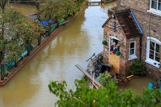 Flooding in Ironbridge, Shropshire, as residents in riverside properties in the area have been told to leave their homes and businesses (PA)