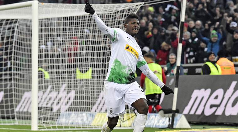 Moenchengladbach's Breel Embolo celebrates after their third goal by Hermann during the German Bundesliga soccer match between Borussia Moenchengladbach and SC Freiburg (Source: AP)