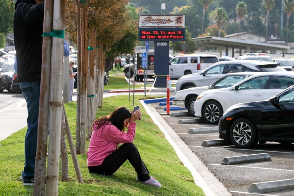 A parent waits outside of Saugus High School in Santa Clarita, California, on Thursday, after an active shooter was reported at the school about 7:30 a.m. (Photo: Los Angeles Daily News via Getty Images)