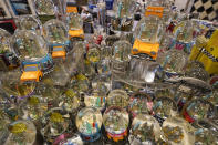 Souvenir snow globes featuring New York City themes are on display for sale at Memories of New York gift shop, Thursday, Nov. 12, 2020, in New York. In souvenir shops from Times Square to the World Trade Center, shelves full of T-shirts and trinkets still love New York, as the slogan goes. But the proprietors wonder when their customers will, again. The coronavirus has altered many aspects of life and business in the United States' biggest city, and the pandemic is taking a major toll on the gifts-and-luggage stores that dot tourist-friendly areas. After setting records year after year since 2010, travel to New York has plummeted during the pandemic. (AP Photo/Mary Altaffer)