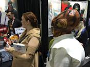 The Mon Calamari officer is known for his tactical prowess. Here, he's waiting in line for the new Darth Vader novel, 'Lords of the Sith.'